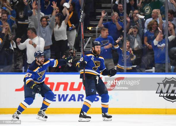 David Perron and Ryan O'Reilly of the St. Louis Blues celebrate O'Reilly's first period goal during Game Four of the 2019 NHL Stanley Cup Final...