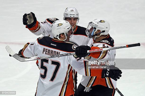 David Perron of the Anaheim Ducks celebrates a goal against the Chicago Blackhawks with teammates Mike Santorelli and Ryan Getzlaf at the United...