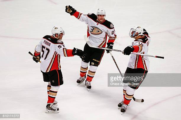 David Perron of the Anaheim Ducks celebrates with Mike Santorelli and Ryan Getzlaf after scoring against the Chicago Blackhawks in the third period...