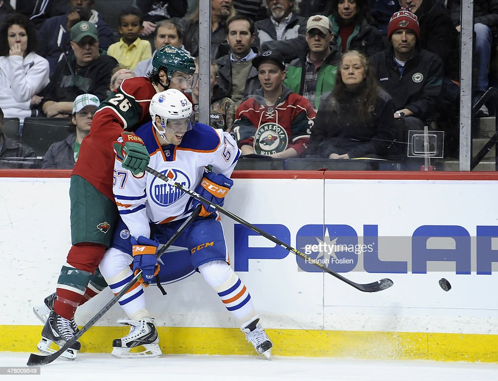 David Perron #57 of the Edmonton Oilers blocks Matt Moulson #26 of the Minnesota Wild from the puck during the first period of the game on March 11, 2014 at Xcel Energy Center in St. Paul, Minnesota. The Oilers defeated the Wild 4-3 in a shootout.