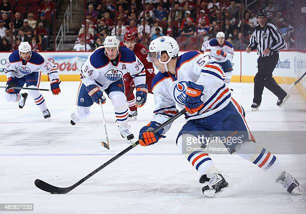 David Perron of the Edmonton Oilers skates with the puck during the second period of the NHL game against the Phoenix Coyotes at Jobingcom Arena on...