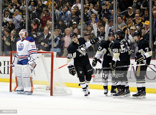 David Perron of the Pittsburgh Penguins celebrates his first period goal during the game against the Edmonton Oilers at Consol Energy Center on March...