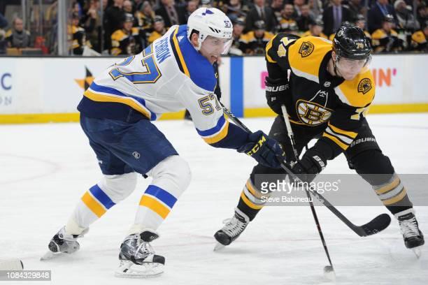 David Perron of the St Louis Blues against Jake DeBrusk of the Boston Bruins at the TD Garden on January 17 2019 in Boston Massachusetts