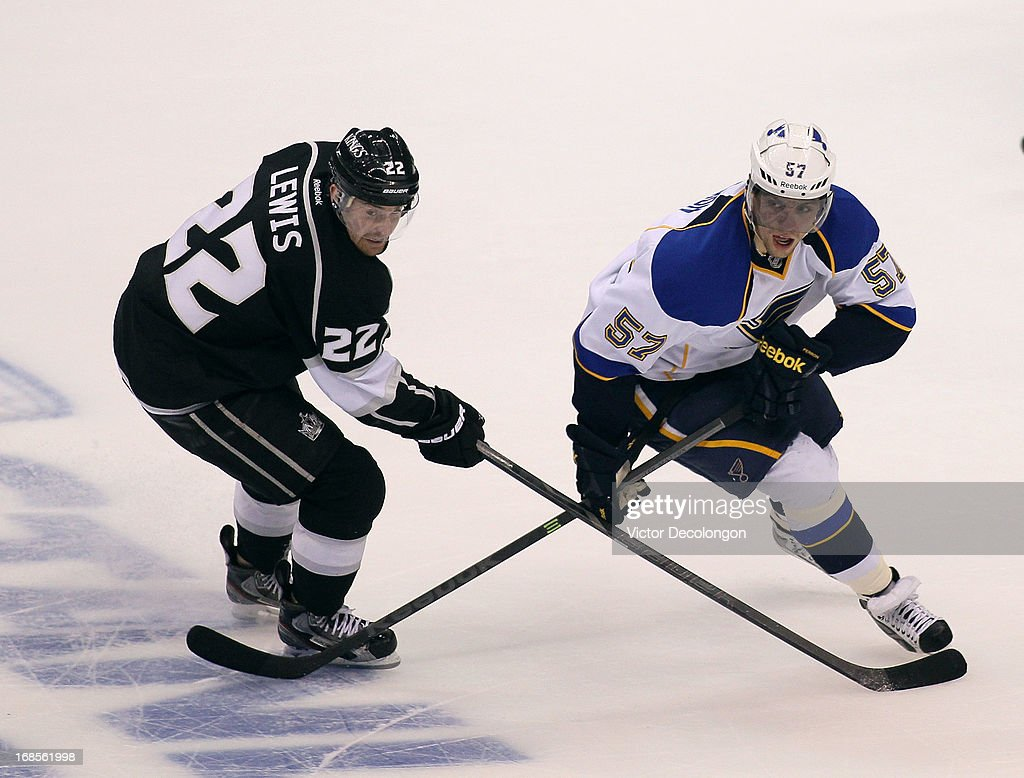 David Perron #57 of the St. Louis Blues and Trevor Lewis #22 of the Los Angeles Kings vie for position during Game Six of the Western Conference Quarterfinals during the 2013 NHL Stanley Cup Playoffs at Staples Center on May 10, 2013 in Los Angeles, California. The Kings defeated the Blues 2-1 to win the series 4 games to 2 and advance to the Western Conference Semifinals.