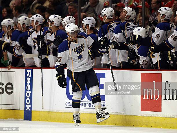 David Perron of the St. Louis Blues celebrates his 2nd period goal with teammates against the Chicago Blackhawks at the United Center on October 18,...