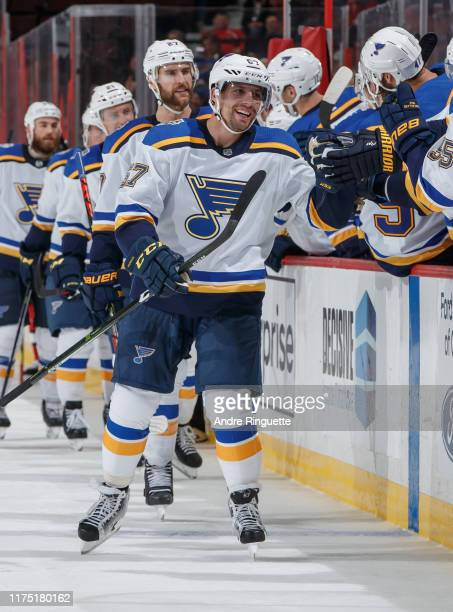 David Perron of the St. Louis Blues celebrates his third period goal against the Ottawa Senators with teammates at the players bench at Canadian Tire...