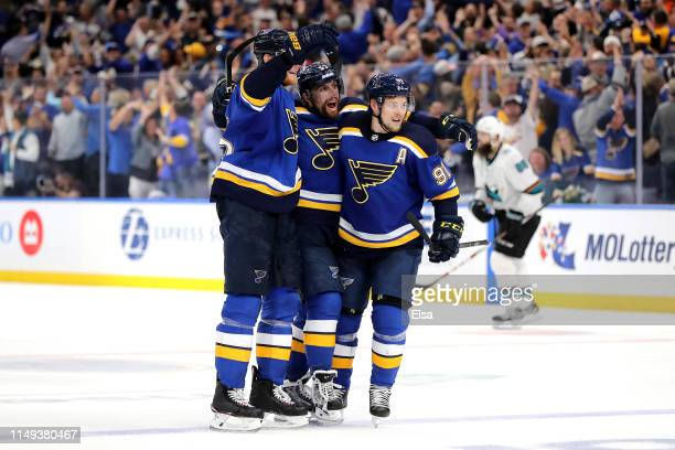 David Perron of the St Louis Blues celebrates with Colton Parayko and Vladimir Tarasenko after scoring his second goal on Martin Jones of the San...