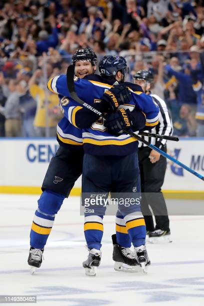 David Perron of the St Louis Blues celebrates with Colton Parayko after scoring his second goal on Martin Jones of the San Jose Sharks during the...