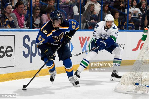 David Perron of the St Louis Blues handles the puck as Alexander Edler of the Vancouver Canucks defends on February 16 2017 in St Louis Missouri