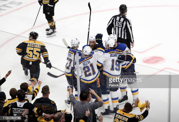 David Perron of the St Louis Blues is congratulated by his teammates after scoring a third period goal against the Boston Bruins in Game Five of the...