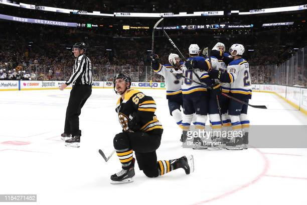 David Perron of the St Louis Blues is congratulated by his teammates after scoring a third period goal as Noel Acciari of the Boston Bruins in Game...