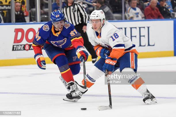 David Perron of the St Louis Blues pressures Anthony Beauvillier of the New York Islanders at Enterprise Center on February 27 2020 in St Louis...