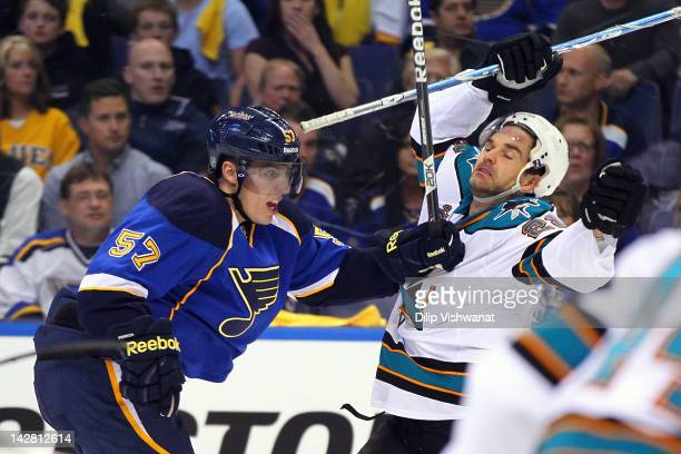 David Perron of the St Louis Blues pushes Dan Boyle of the San Jose Sharks out of his way during Game One of the Western Conference Quarterfinals...