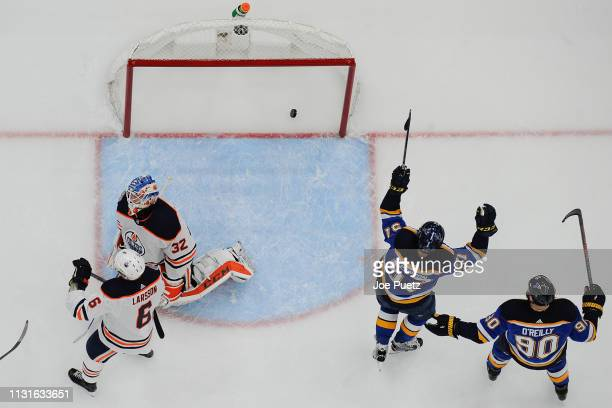 David Perron of the St Louis Blues reacts after scoring a goal past Anthony Stolarz of the Edmonton Oilers at Enterprise Center on March 19 2019 in...