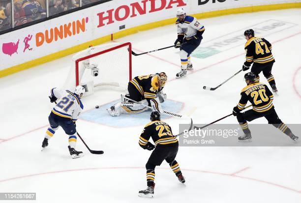 David Perron of the St. Louis Blues scores a third period goal against Tuukka Rask of the Boston Bruins in Game Five of the 2019 NHL Stanley Cup...