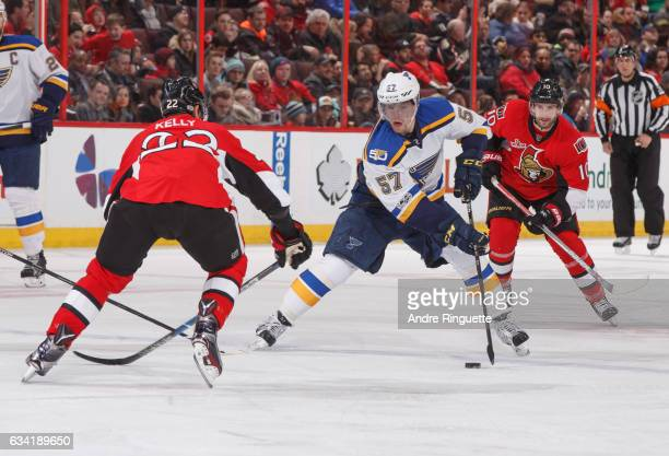 David Perron of the St Louis Blues stickhandles the puck across the blue line against Chris Kelly and Tom Pyatt of the Ottawa Senators at Canadian...
