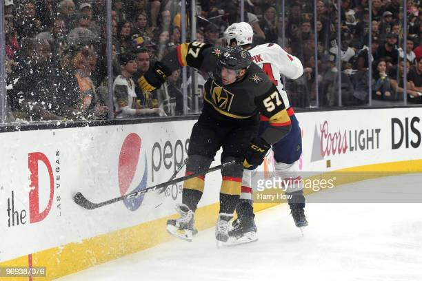 David Perron of the Vegas Golden Knights and Brooks Orpik of the Washington Capitals battle along the boards during the first period in Game Five of...