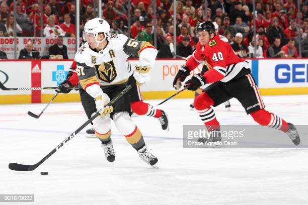 David Perron of the Vegas Golden Knights approaches the puck ahead of John Hayden of the Chicago Blackhawks in the first period at the United Center...