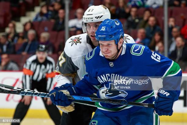 David Perron of the Vegas Golden Knights checks Derek Dorsett of the Vancouver Canucksduring their NHL game at Rogers Arena November 16 2017 in...
