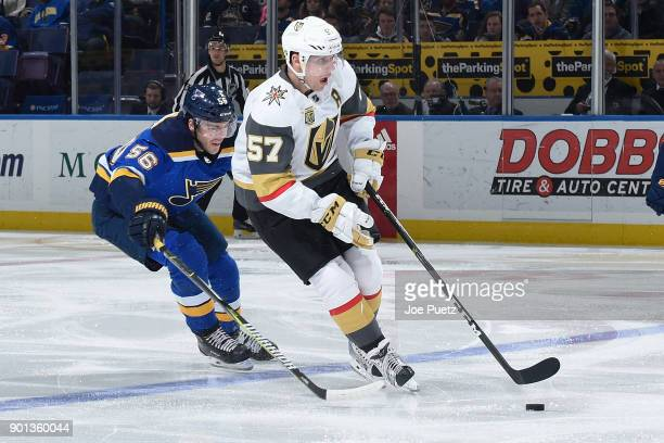David Perron of the Vegas Golden Knights handles the puck as Magnus Paajarvi of the St Louis Blues adds pressure at Scottrade Center on January 4...