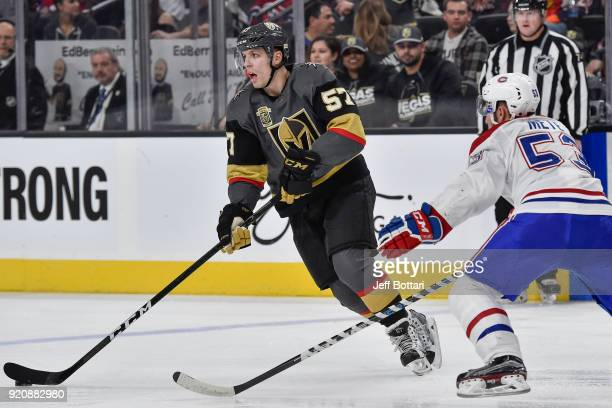 David Perron of the Vegas Golden Knights handles the puck with Victor Mete of the Montreal Canadiens defending during the game at TMobile Arena on...