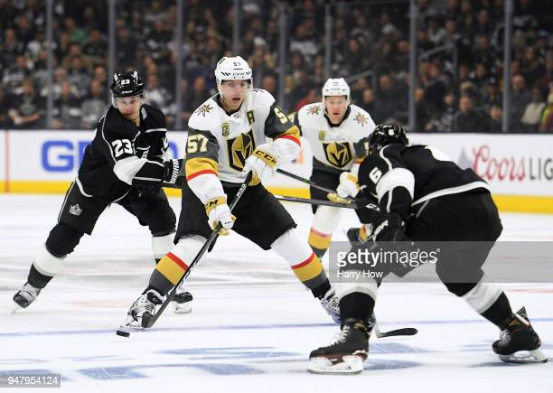 David Perron of the Vegas Golden Knights makes a pass between Jake Muzzin and Dustin Brown of the Los Angeles Kings during the first period in Game...