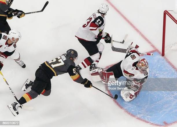 David Perron of the Vegas Golden Knights misses an attempt against Antti Raanta of the Arizona Coyotes during the first period during the Golden...