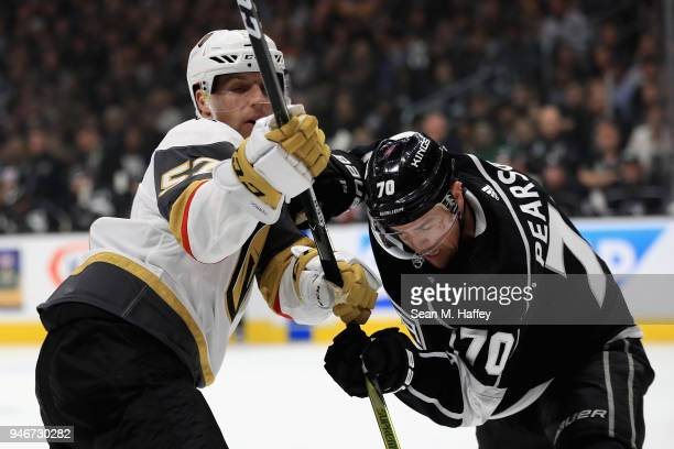 David Perron of the Vegas Golden Knights pushes Tanner Pearson of the Los Angeles Kings during the first period in Game Three of the Western...