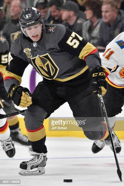 David Perron of the Vegas Golden Knights skates with the puck against the Calgary Flames during the game at TMobile Arena on March 18 2018 in Las...