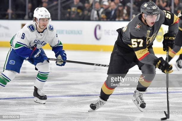 David Perron of the Vegas Golden Knights skates with the puck while Brendan Leipsic of the Vancouver Canucks defends during the game at TMobile Arena...