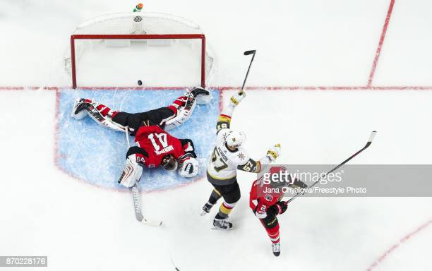David Perron the Vegas Golden Knights celebrates a second period goal scored by teammate Erik Haula as Craig Anderson and Dion Phaneuf of the Ottawa...