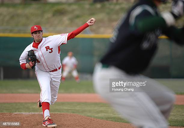 David Peterson of Regis Jesuit High School is pitching against Mountain Vista High School in the 7th inning of the game at Regis Jesuit High School...