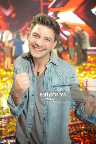 David Pfeffer poses during the winners photocall at the 'The X Factor Live' TVShow Final on December 06 2011 in Cologne Germany