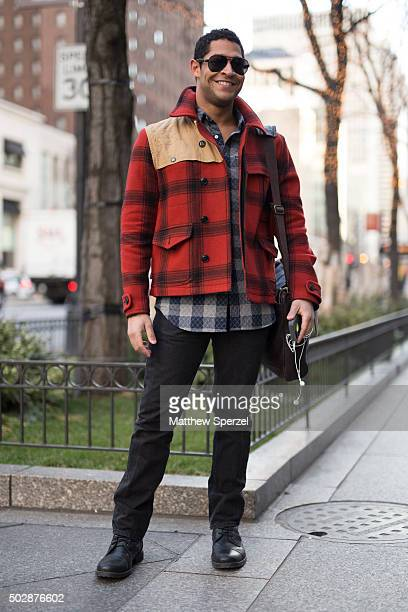 David Phaeton is seen on Michigan Avenue wearing a redorange pattern RL Rugby coat black Express pants Banana Republic black shoes checker shirt and...