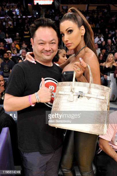 David Phan and Holly Sonders attend a basketball game between the Los Angeles Lakers and the Denver Nuggets at Staples Center on December 22 2019 in...