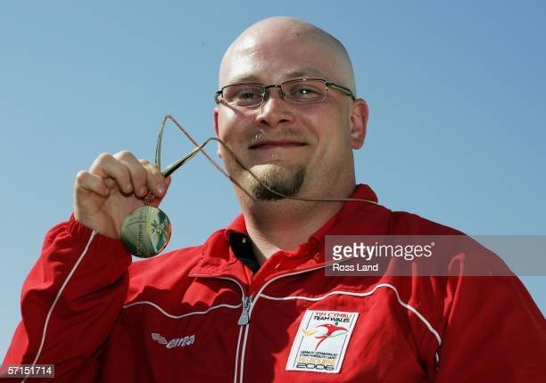 David Phelps of Wales poses with his gold medal after his victory in the Men's 50m Rifle Prone Final during Small Bore Shooting at the Melbourne...
