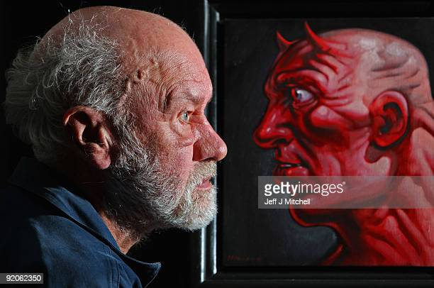 David Phillis a customer at McTears auctioneers views Alter Ego a self portrait by artist Peter Howson on October 20 2009 in Glasgow Scotland More...