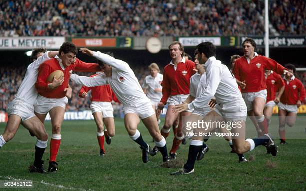 David Pickering of Wales breaks between Kevin Simms and Rory Underwood of England during their Five Nations rugby union match at the National Stadium...