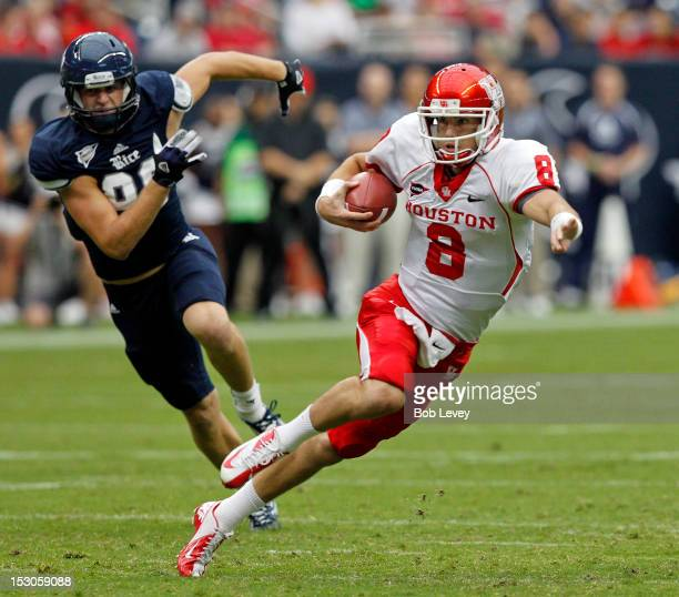 David Piland of the Houston Cougars scrambles out of the pocket against the Rice Owls at Reliant Stadium on September 29 2012 in Houston Texas