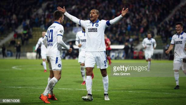 David Pisot of Karlsruhe celebrates his team's second goal with team mate Marvin Wanitzek during the 3 Liga match between Karlsruher SC and SG...