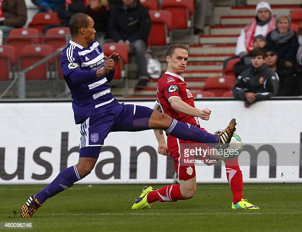 David Pisot of Osnabrueck battles for the ball with Sven Michel of Cottbus during the third league match between FC Energie Cottbus and VFL...
