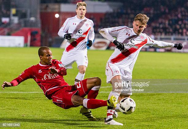 David Pisot of Wuerzburg challenges Marc Hornschuh of St Pauli during the Second Bundesliga match between FC Wuerzburger Kickers and FC St Pauli at...