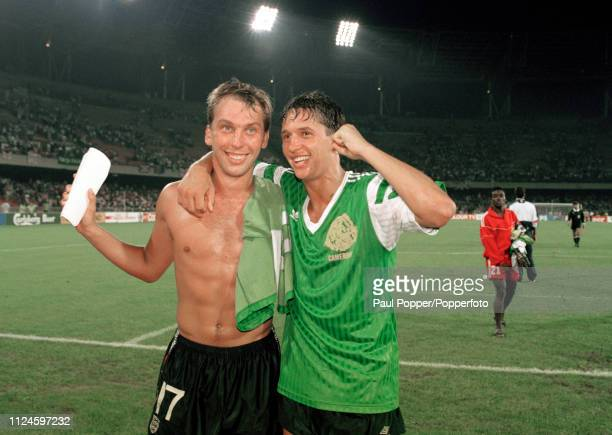 David Platt and Gary Lineker of England celebrate after the 1990 FIFA World Cup Quarter Final between Cameroon and England at the Stadio San Paolo on...