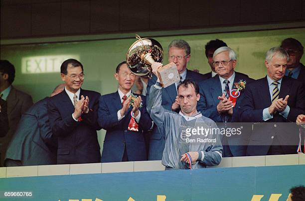 David Platt lifts the Century Challenge Cup after England beat the Hong Kong Golden Select XI 10 at the Happy Valley Stadium Hong Kong during the...