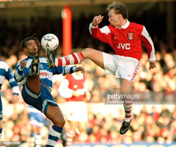 David Platt of Arsenal and Trevor Sinclair of Queens Park Rangers battle for the ball during an FA Carling Premiership match at Highbury on December...