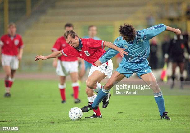 David Platt of England and Zanotti of San Marino during a World Cup qualifier match between San Marino and England, 17th November 1993. England won...