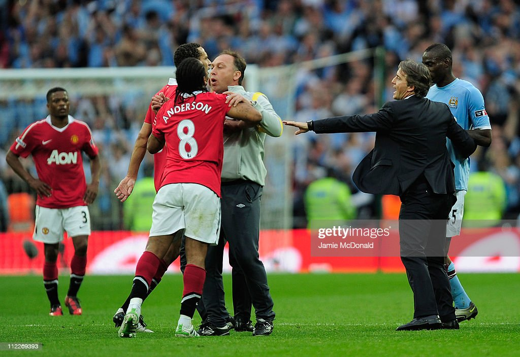 David Platt of Man City holds back Anderson and Rio Ferdinand of Man Utd at the final whistle during the FA Cup sponsored by E.ON semi final match between Manchester City and Manchester United at Wembley Stadium on April 16, 2011 in London, England.