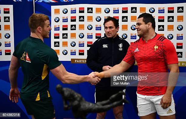 David Pocock of Australia and Guilhem Guirado of France meet for the coin toss alongside Referee Glen Jackson prior to the international match...