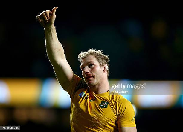 David Pocock of Australia celebrates by giving the thumbs up to the fans after winning the 2015 Rugby World Cup Semi Final match between Argentina...