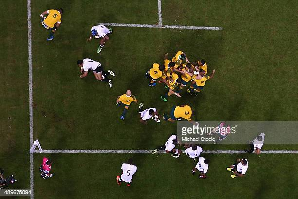David Pocock of Australia celebrates scoring his sides opening try during the 2015 Rugby World Cup Pool A match between Australia and Fiji at...